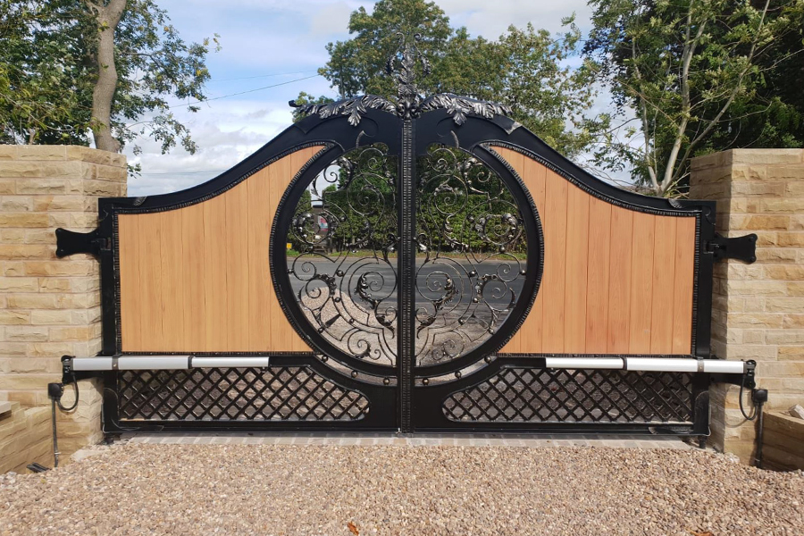 electric wooden gate with cast iron
